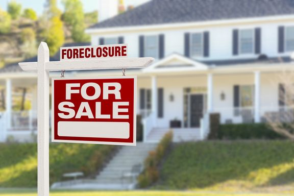 Buying a Foreclosed Home: Pros, Cons, and a Step-By-Step Guide